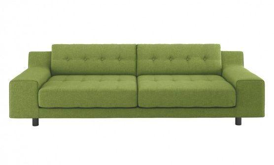 green wool three seater sofa
